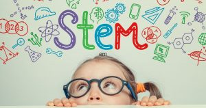 Small girl looking up and the word STEM written in computer generated text and icons.